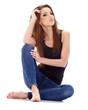 Beautiful brunette woman sitting on the floor . Studio shoot.