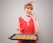 Retro housewife sneaking cookies
