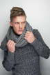 Male Fashion Model Holding Winter Scarf