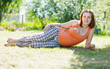 pregnant woman in  summer park
