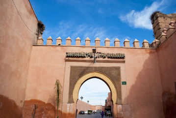 Old city wall with gate in Marrakech