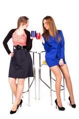 Two business girls having coffee break