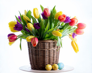 Easter. Fresh spring tulips flowers and Easter eggs