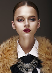 Arrogance. Stately Luxurious Woman in Wool Collar and Necklace