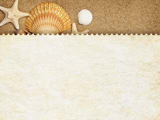 Summer background - blank paper sheet on sand