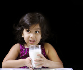 A cute girl drinking milk