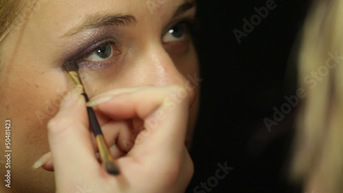 Woman applying eye makeup