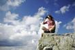 Woman sitting on a mountain with binocular