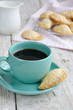 Cup of black coffee and fresh homemade bakery
