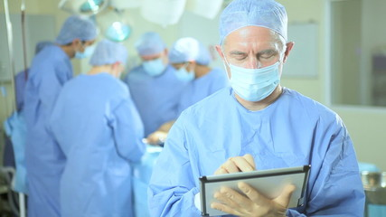 Close Up Surgical Doctor Tablet Technology Operating Theater