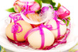 easter eggs with pink ribbon on the plate