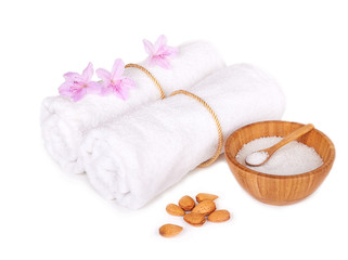 spa items: flowers with towels and salt isolated