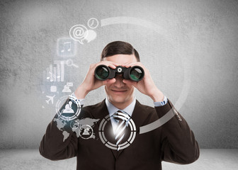 Technology concept. Businessman with biboculars and virtual inte