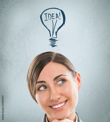 Idea woman - brainstorming. Beautiful young businesswoman contem