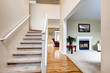 Classic home interior with living room and staircase.