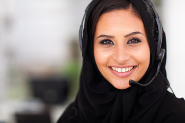 middle eastern businesswoman with headphones