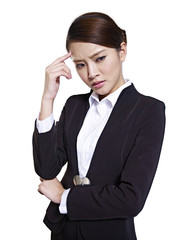 asian businesswoman thinking with hand on forehead