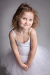 Cute little girl in a ballet dress