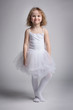 Happy little girl in a ballet dress
