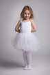 Little curly girl in a ballet dress