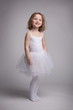 Little blond girl in a ballet dress