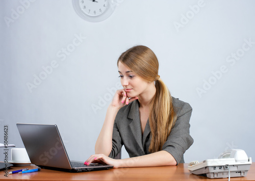 Young female executive working on laptop