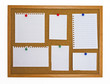 Multiple type of note papers pinned on cork board
