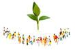 緑の植物を囲む大勢の人々