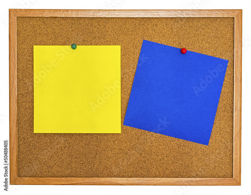Yellow and blue note papers pinned on cork board