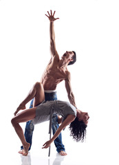 Muscular dancer expressing emotions while holding his partner