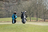 Two Golf Bags Standing During a Golfing Round.