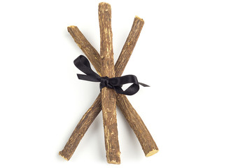 licorice roots tied with a black ribbon