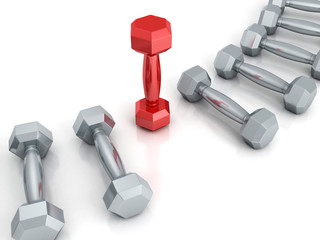 row of metallic dumbbells with red one