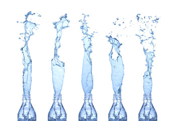Water splashes from a bottles. Isolated on white