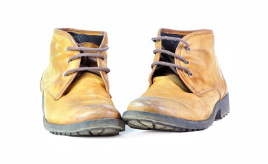 Pair of shabby leather boots isolated