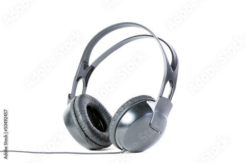 Big black headphones isolated over white