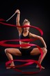 Artistic photo of gymnast girl with ribbon