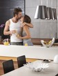 Kissing couple in the kitchen in the morning