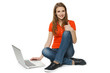 Woman sitting on floor with laptop making thumb up
