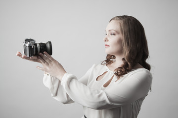 Woman holding camera for self portrait