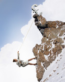 businesswoman climbing mountain
