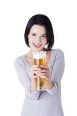 Beautiful happy woman with beer