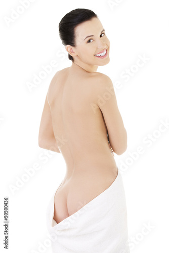 Young beautiful nude woman with towel around her waist
