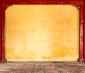 Yellow stucco wall with pattern in frame.