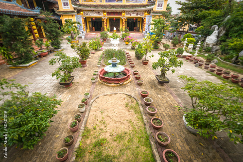 Buddhist temple and its green yard in Hoi An.