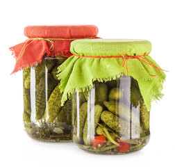 Pickles cucumbers and gherkins in glass jar Isolated on white