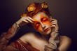 Bodyart. Artistic Woman. Red - Gold Makeup and Flowers. Coloring