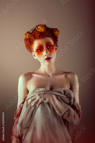 Unusual Redhead Woman with False Red Eyelashes. Fantasy