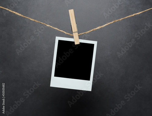 Blank instant photo over concrete wall with clipping path