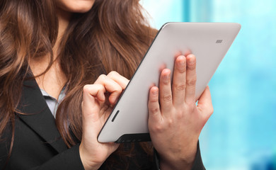 Young businesswoman using a tablet